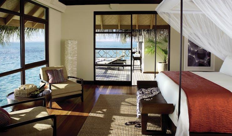 Four Seasons Kuda Huraa Maldives villa bedroom canopied bed private terrace