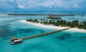 LUX Maldives resort aerial shot island beach jetty villas over the sea
