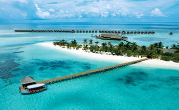 LUX Maldives resort aerial shot island beach jetty villas over the sea