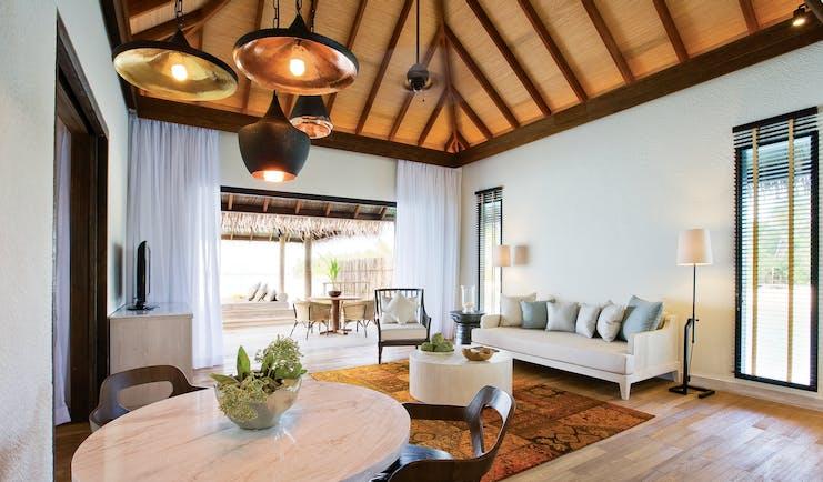 Maalifushi garden villa interio, living area, sofa, dining table, fresh modern interiors