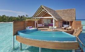 Milaidhoo water pool villa exterior, infinity pool, villa rooms, decking, over sea water