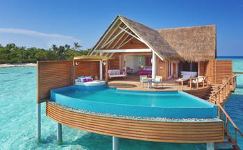 Milaidhoo water pool villa exterior, infinity pool, villa rooms, decking, over sea water
