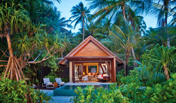 Niyama Maldives beach pool villa exterior villa private pool surrounded by greenery