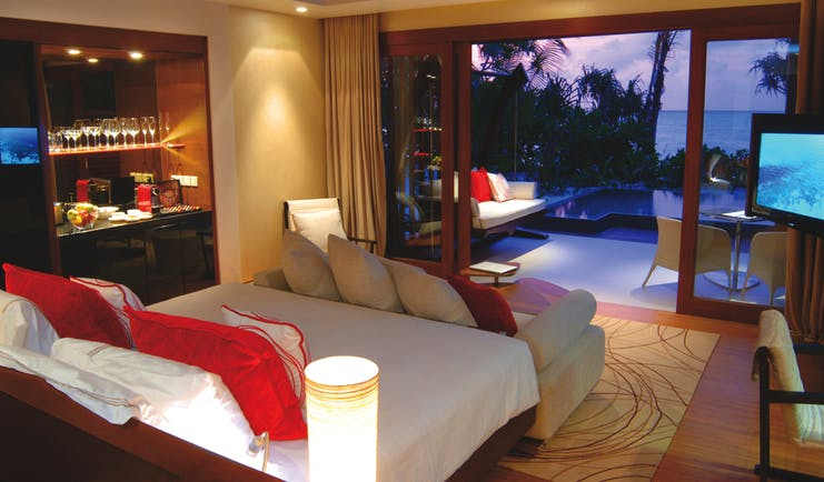 Niyama Maldives beach pool villa bed sofa modern décor private pool leading to beach