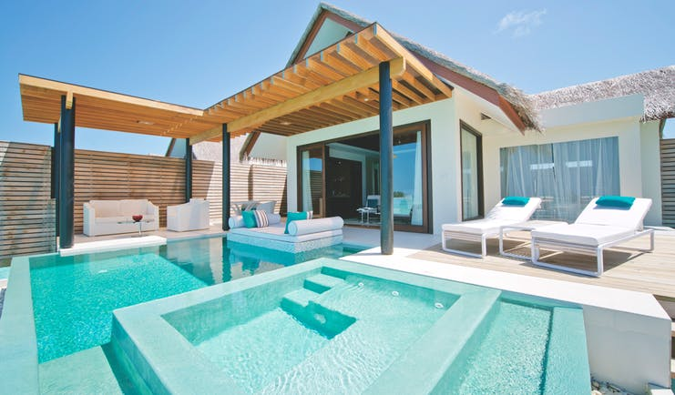 Niyama Maldives deluxe water villa private pool jacuzzi outdoor seating sun loungers