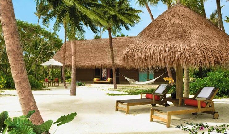 One Only Reethi Rah Maldives beach villa exterior villa leading onto beach hammock sun loungers