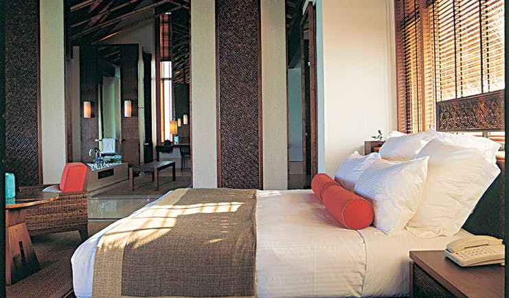 One Only Reethi Rah Maldives villa bedroom bed armchair modern décor