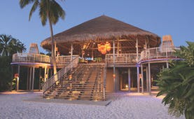 Six Senses Laamu Maldives leaf restaurant exterior large veranda hut on sand