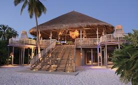 Six Senses Laamu Maldives leaf restaurant exterior large veranda hut on sand