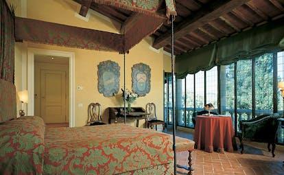 Soneva Fushi Maldives bedroom four poster canopied bed sofa modern décor