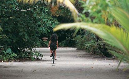 Soneva Fushi Maldives bicycle riding through nature