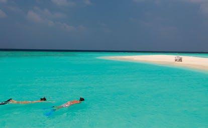 Soneva Fushi Maldives snorkelling clear blue sea