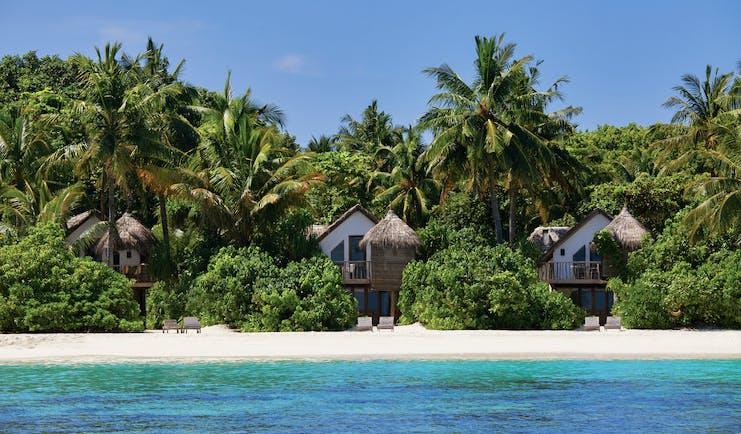 Soneva Fushi Maldives villas exteriors on the beach overlooking sea