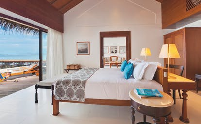 Residence Maldives  beach villa bedroom bed wardrobe modern decor