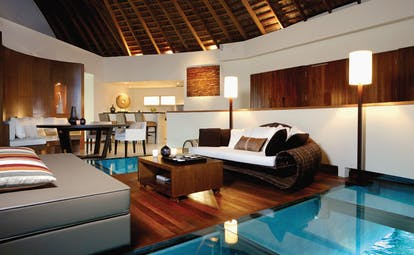 W Retreat Maldives ocean haven interior sofas table glass floors over sea modern décor