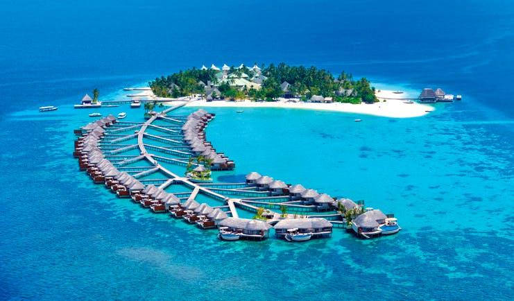 W Retreat Maldives aerial shot of resort island villas reaching into the sea