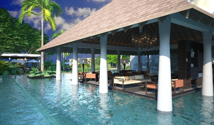 View from the pool of the lounge, a seating area with hut style roof with white pillars and shown beside the pool