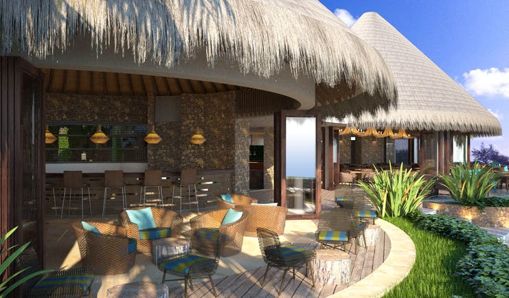 Seafood bar with chairs and tables set up beneath a beach hut style roof