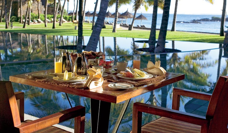 Constance Belle Mare Plage Mauritius table set for breakfast fresh fruit ocean views