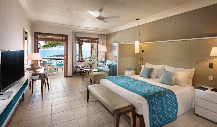 Constance Belle Mare Plage Mauritius junior suite bed lounge area modern décor sea views