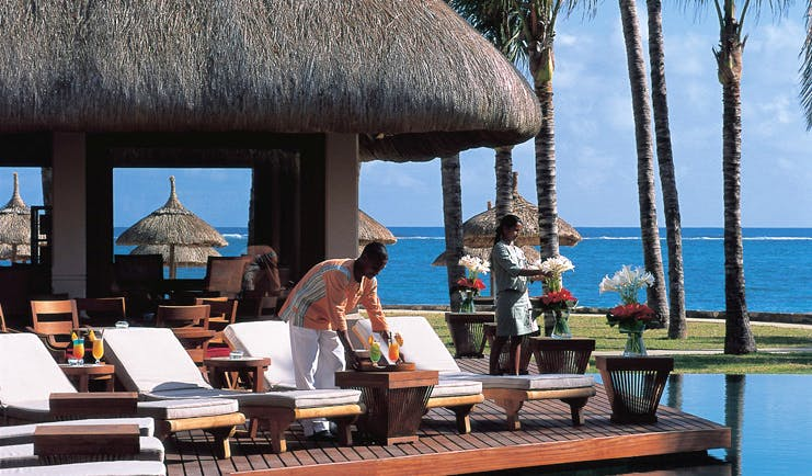 Constance Belle Mare Plage Mauritius terrace sun loungers overlooking pool