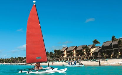 Constance Belle Mare Plage Mauritius water sports kayaks boats yachts on the water and beach