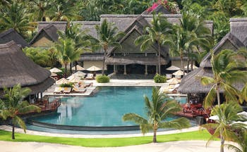 Constance Le Prince Maurice Mauritius pool sun loungers umbrellas palm trees
