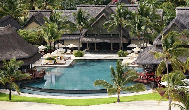Constance Le Prince Maurice Mauritius pool sun loungers umbrellas palm trees