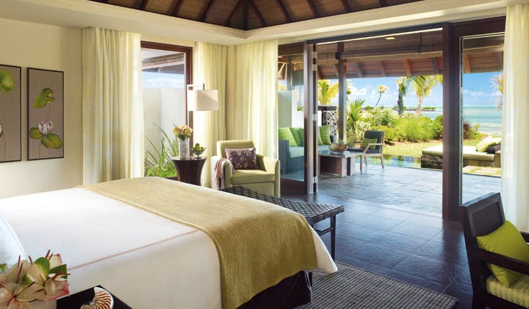 Four Seasons Mauritius bedroom modern decor patio area with sofa and ocean view