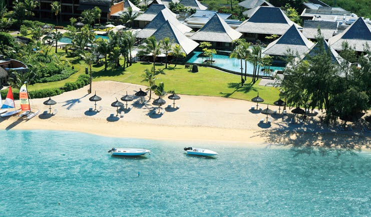 Heritage Awali Mauritius aerial view bungalows swimming pool beach boats and ocean