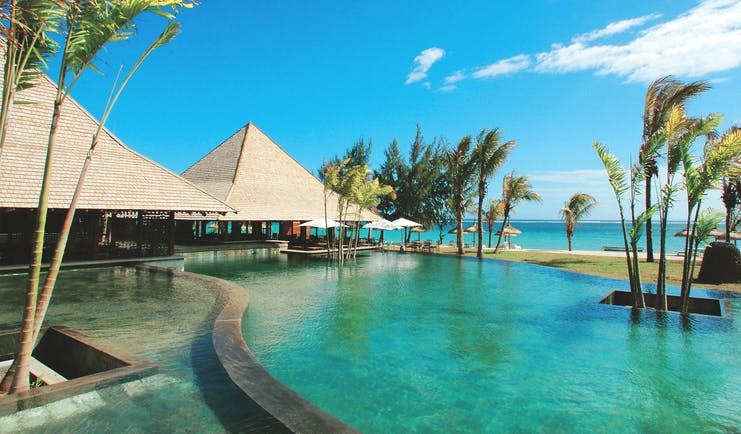 Heritage Awali Mauritius Amafrooty restaurant infinity pool dining pavilion ocean view