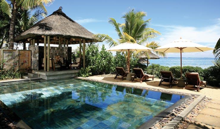 Heritage Awali Mauritius beach villa exterior private pool terrace overlooking beach