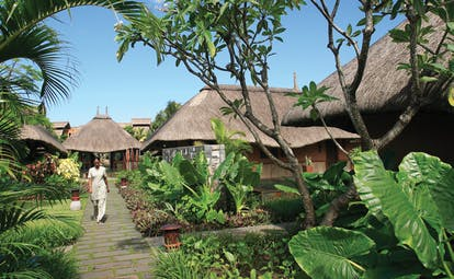 Heritage Awali Mauritius spa exterior huts with wicker roof gardens and pathways