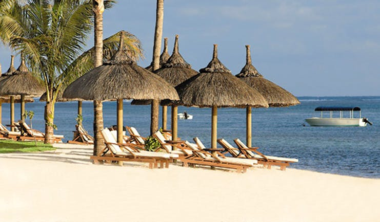 Le Telfair Mauritius beach sun beds umbrellas white sand ocean