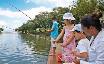 Le Telfair Mauritius kids' club children fishing with supervisor