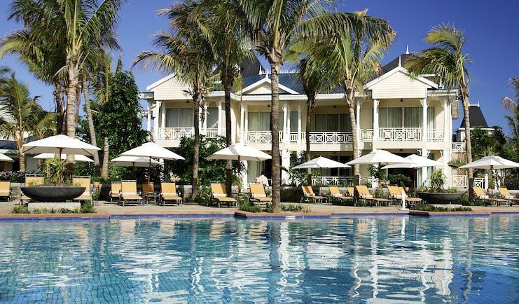 Le Telfair Mauritius villa exterior overlooking beach palm trees white sand