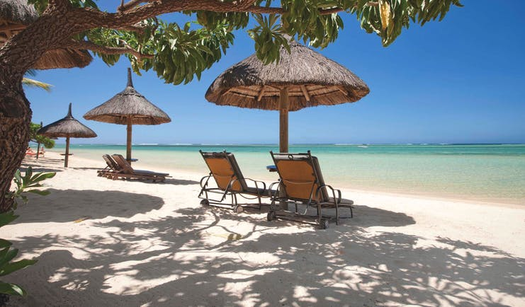 Heritage the Villas Mauritius beach sun loungers umbrellas white sands blue sea