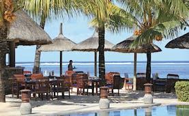 Heritage the Villas Mauritius poolside seating area overlooking sea