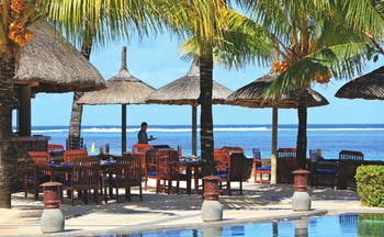 Heritage the Villas Mauritius poolside seating area overlooking sea
