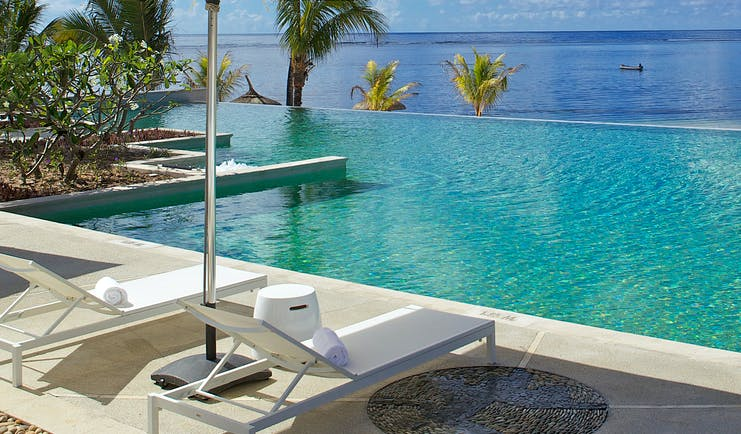 Long Beach infinity pool, sun loungers, umbrella, overlooking sea