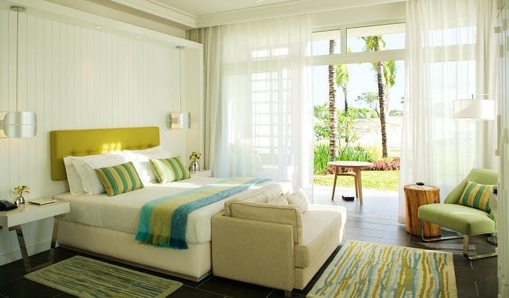 Long Beach junior suite, bed, sofa, doors leading to patio, bright modern decor