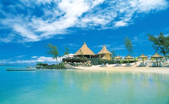 Lux Grand Gaube Mauritius beach white sands clear blue water sun loungers umbrellas