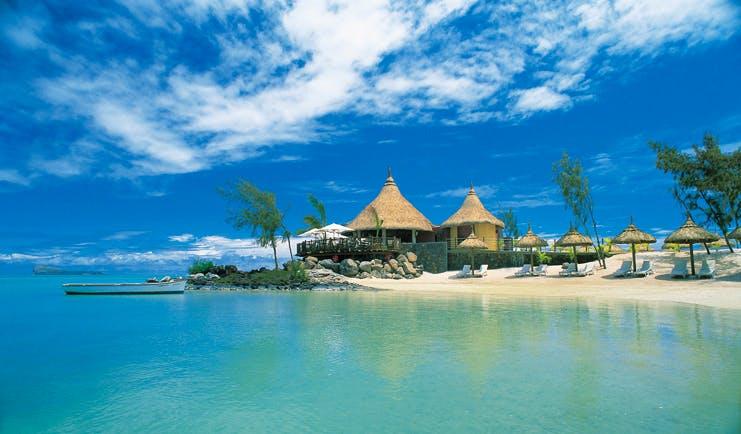 Lux Grand Gaube Mauritius beach white sands clear blue water sun loungers umbrellas