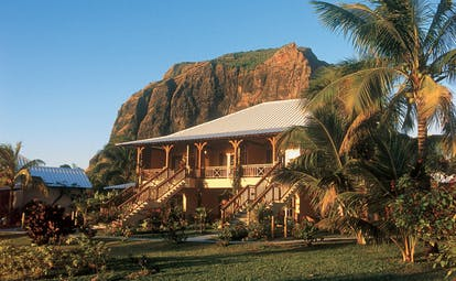 Lux Le Morne Mauritius exterior hotel building lawn trees mountain in background