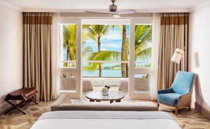 Lagoon balcony room with bed ad balcony looking over lagoon