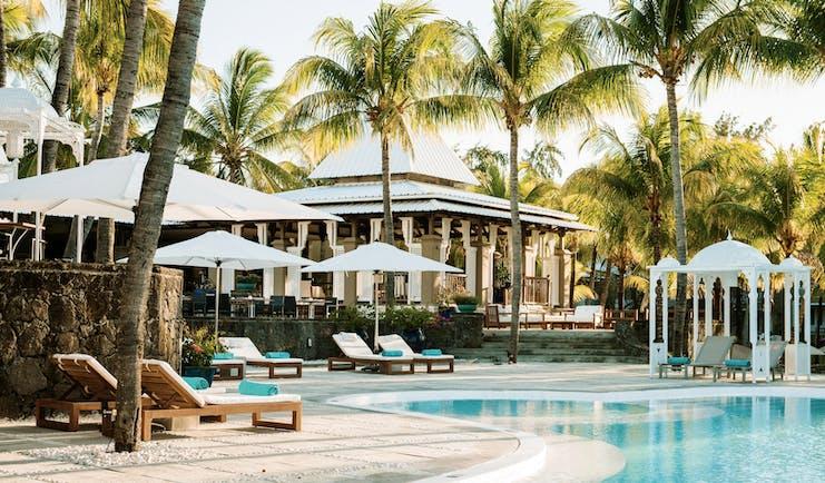 Paradise Cove swimming pool, sun loungers, umbrellas, palm trees