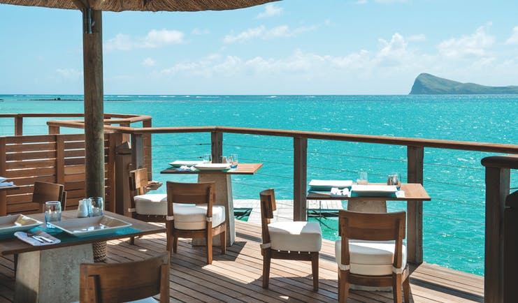 Paradise Cove restaurant, tables and chairs, on covered decking overlooking sea