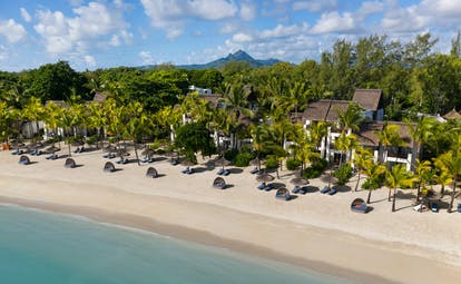 Aerial beach view with sun loungers and umbrellas set out
