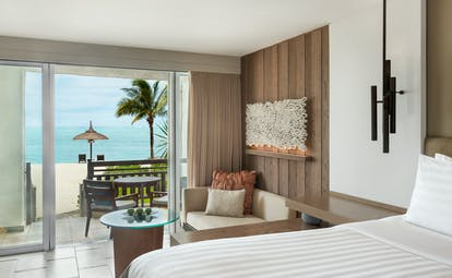 Deluxe coral room with large double bed and seating area