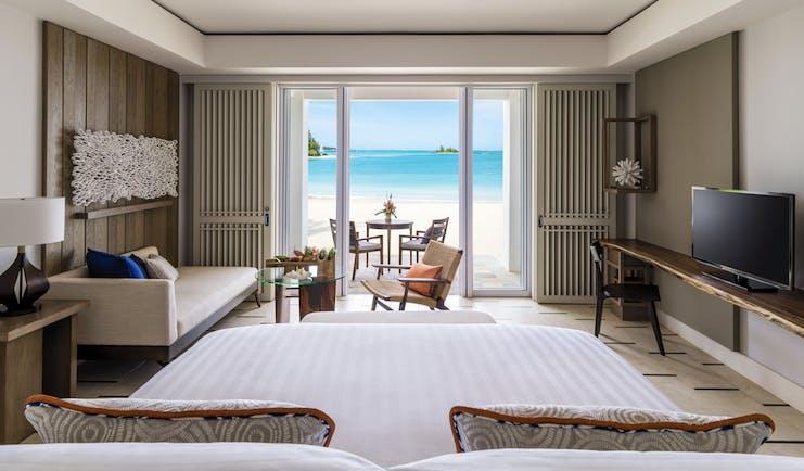 Shangri La Le Touessrok Mauritius hibiscus suite bedroom leading onto beach modern décor